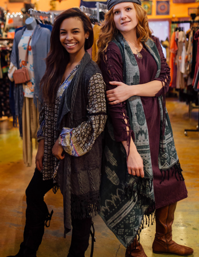 hamsa print vest over lace up sleeve dress and knit vest over multi print top with lace trim